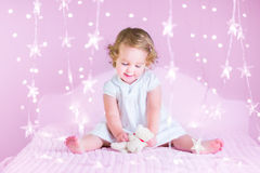 Cute toddler girl in a bedroom Stock Image