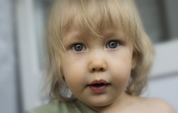 Cute toddler girl with big beautiful eyes shallow depth of field Royalty Free Stock Images