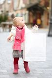 Cute toddler girl at Christmas shopping street Stock Image