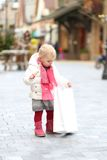 Cute toddler girl at Christmas shopping street Stock Photography