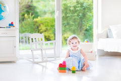 Cute toddler girl with curly hair wearing blue dress Royalty Free Stock Photography