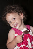 Cute Toddler Girl Eating Ice-Cream. Cute Girl Eating Ice-Cream Stock Photography