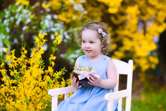 Cute toddler girl enjoying egg hunt in the garden Royalty Free Stock Photography