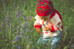 Cute toddler girl with funny face in a meadow Stock Image