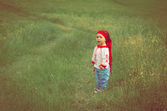Cute toddler girl with funny face in a meadow Royalty Free Stock Photography