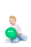 Cute toddler girl with green balloon Stock Images