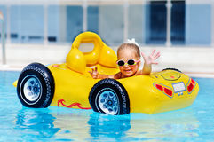 Cute toddler girl have a fun in pool outdoor Stock Photos