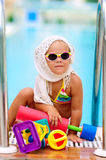 Cute toddler girl have a fun in pool outdoor Stock Photography