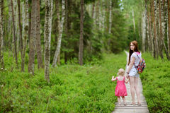 Cute toddler girl and her mother outdoors Royalty Free Stock Images