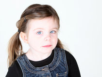 Cute toddler girl looking at camera. On white background with copyspace Stock Images