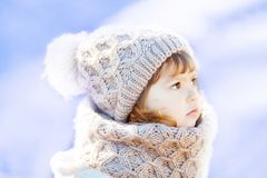 Little cute toddler girl outdoors on a sunny winter day. Royalty Free Stock Images
