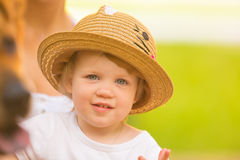 Cute toddler girl in park on summer background. Stock Photography