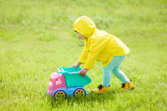 Cute toddler girl playing alone outdoors in spring stock photos