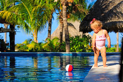 Cute toddler girl playing with ball in swimming Stock Photo