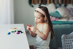 Cute toddler girl playing with plasticine or play dough at home Royalty Free Stock Photography