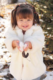 Cute Toddler Girl Playing with Snow Stock Photography