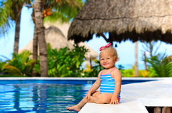 Cute toddler girl playing in swimming pool at Royalty Free Stock Images