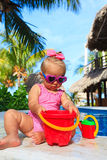 Cute toddler girl playing in swimming pool at the Royalty Free Stock Photo