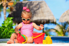 Cute toddler girl playing in swimming pool Stock Image