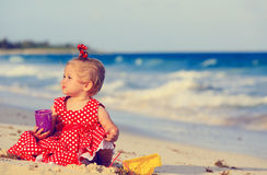 Cute toddler girl playing with toys on beach Stock Image