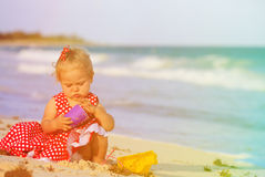 Cute toddler girl playing with toys on beach Royalty Free Stock Photo