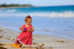 Cute toddler girl playing with toys on beach Stock Photography