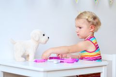 Cute toddler girl playing with toys Stock Photography