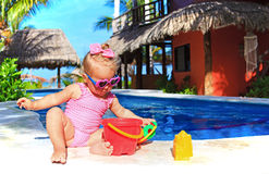 Cute toddler girl playing at tropical beach Stock Image
