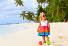 Cute toddler girl playing on tropical beach Stock Photography