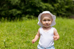 Cute toddler girl running baby steps in nature Stock Photography