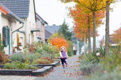 Cute toddler girl running on street in small village Royalty Free Stock Photo