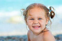 Cute toddler girl on sea background Stock Photography