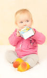 Cute toddler girl sit and drinking juice Royalty Free Stock Images