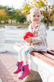 Cute toddler girl sitting on the bench Stock Images
