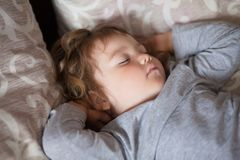 Adorable little girl sleeping in the bed. Cute toddler girl sleep in the bed in her badroom, indoors royalty free stock images