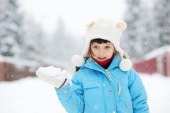 Cute toddler girl in snowsuit posing outdoors Stock Image
