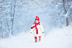 Cute toddler girl in snowy winter forest Royalty Free Stock Photo