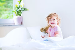 Cute toddler girl waking up Royalty Free Stock Images