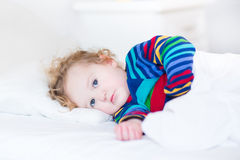 Cute toddler girl waking up in the morning Stock Photos
