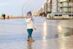 Cute toddler girl walking on winter promenade Royalty Free Stock Photos