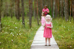 Cute toddler girl walking in the woods Royalty Free Stock Image