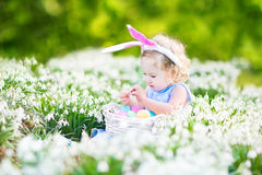Cute toddler girl wearing bunny ears with Easter e Royalty Free Stock Photography