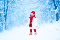 Cute toddler girl in a winter park Stock Image