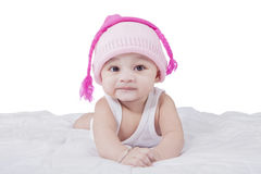 Cute toddler with hat on bed Royalty Free Stock Images