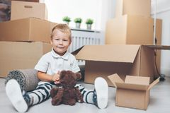 Cute toddler helping out packing boxes stock photography