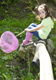 Cute toddler holding a butterfly net  Royalty Free Stock Photo