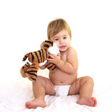 Cute toddler hugging tiger toy. Toddler with toy isolated on white Royalty Free Stock Photography