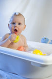 Cute toddler infant baby have fun playing bath white