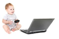 Cute toddler with laptop Royalty Free Stock Photos