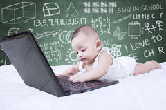 Cute toddler with laptop and doodles Stock Photos